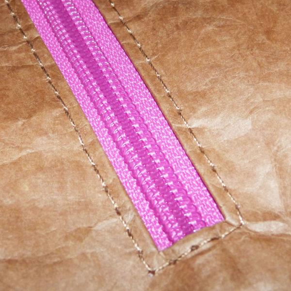 pink zip brown tyvek bag detail